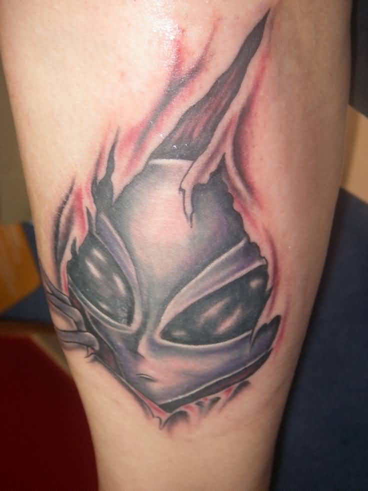 Outstanding Ripped Skin  Tattoo Of Alien Head