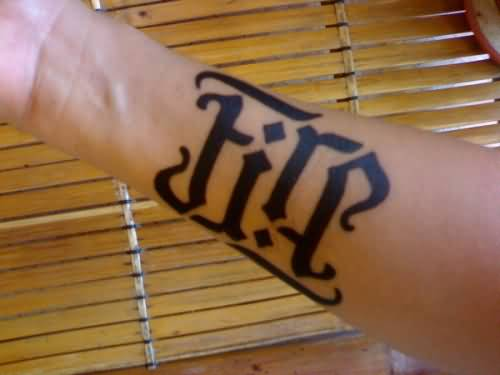 Attractive Fire Ambigram Tattoo On Wrist