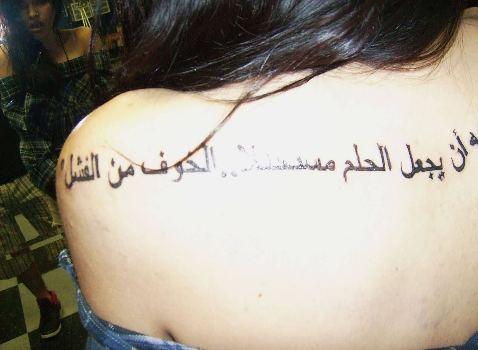 Outstanding Arabic Women Tattoo On Back