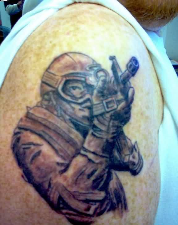Army Soldier Firing With Army Gun Tattoo On Shoulder
