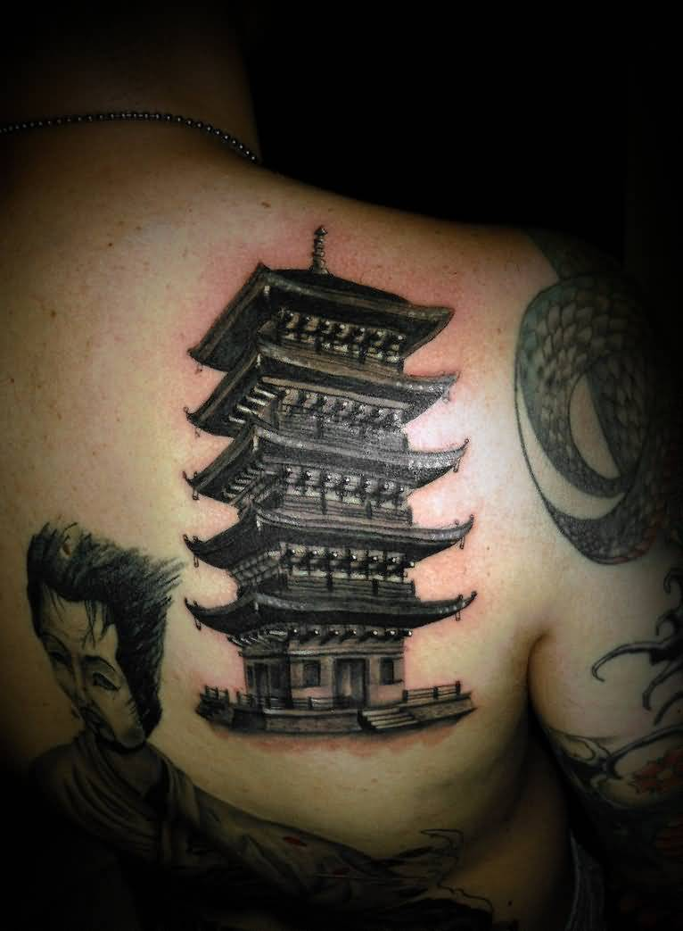 Asian Men And Old Asian House Tattoo On Back