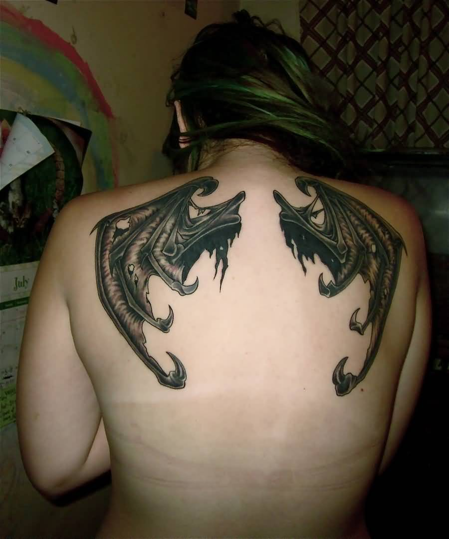 Attractive Bat Wings Tattoo On Lady's Back