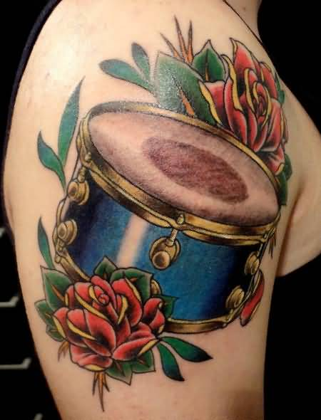 Band Drum And Beautiful Red Flowers Tattoo On Upper Sleeve