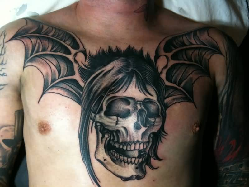 Brilliant Skull And Bat Wings Tattoo For Cool Men