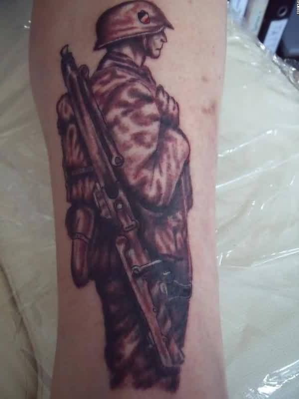 Brilliant Tattoo Of Army Gun