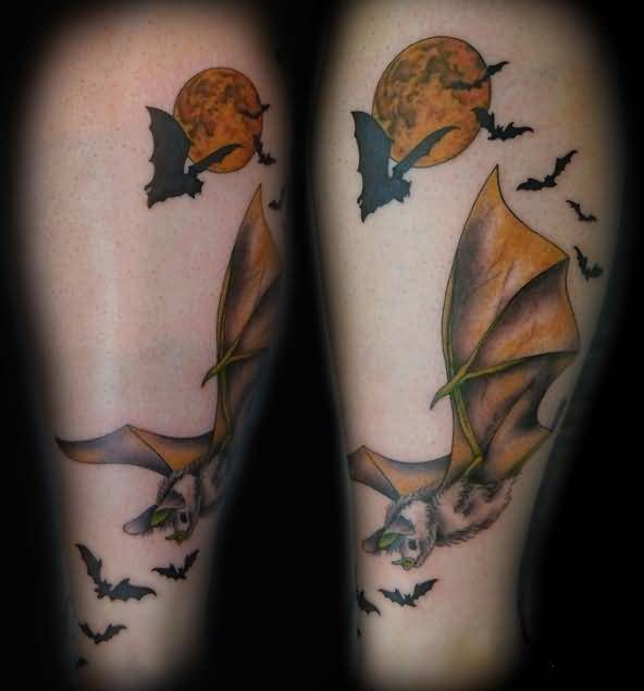 Colourful Moon And Hanging Bat Tattoo Made By Expert