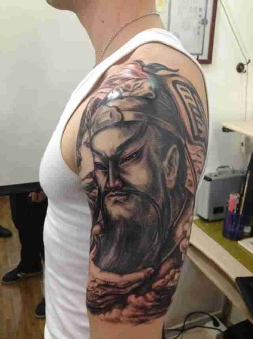 Dangerous Asian Warrior Tattoo On Men's Sleeve