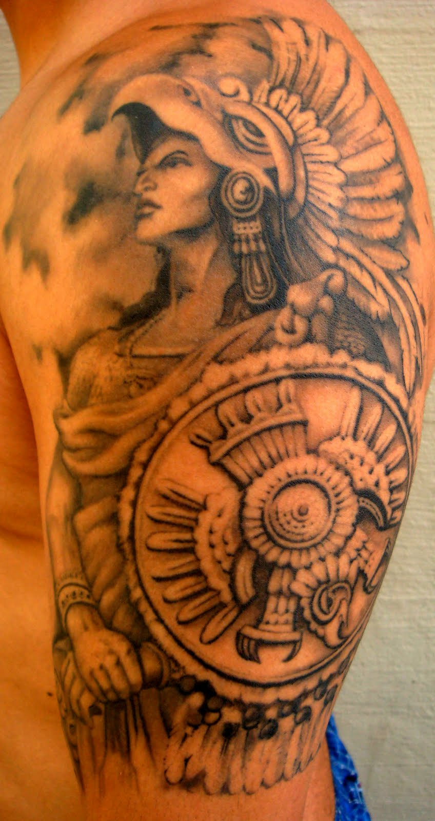 Dangerous Aztec Warrior Hold Roman Shield Tattoo On Sleeve