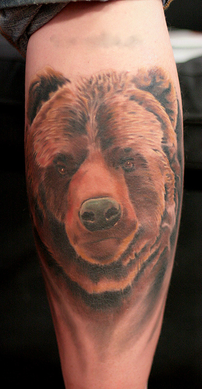 Fabulous Grizzly Bear Face Tattoo On Lower Sleeve