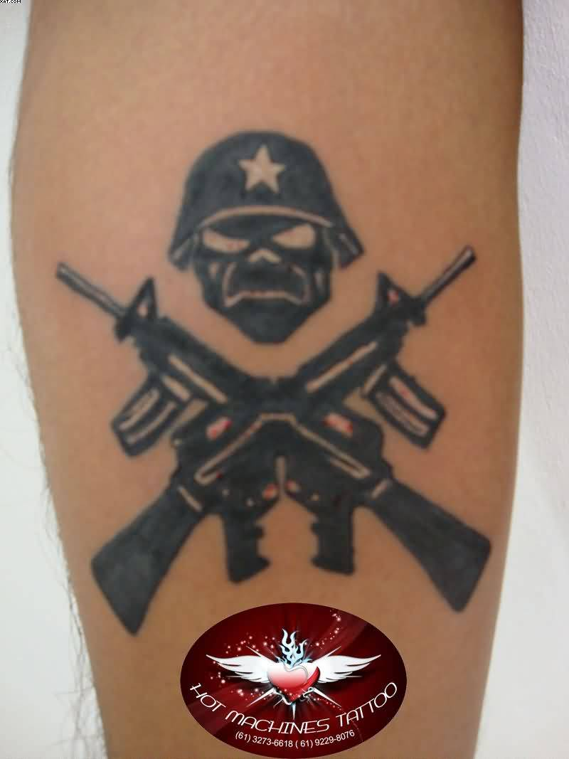 Fascinating Skull Face And Army Gun Tattoo On Arm