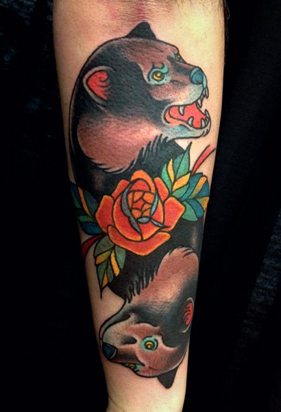 Latest Flower And Angry Bear Tattoo On Arm