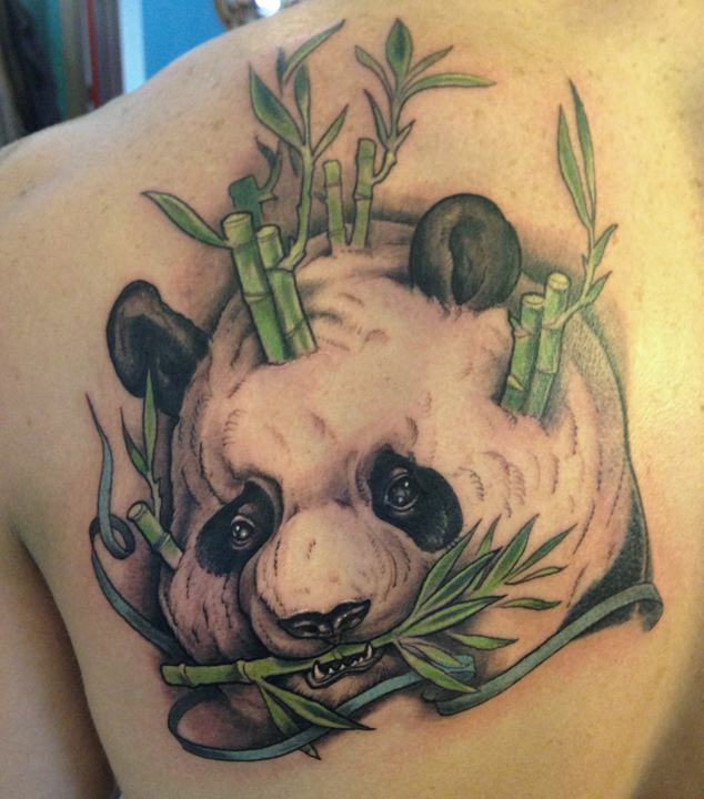 Latest Panda Bear Face Hold Leaf Tattoo On Back Shoulder