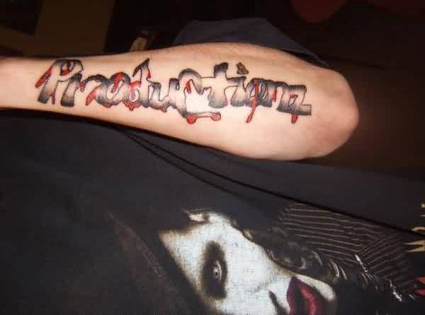 Lower Arm Tattoo With Production Text