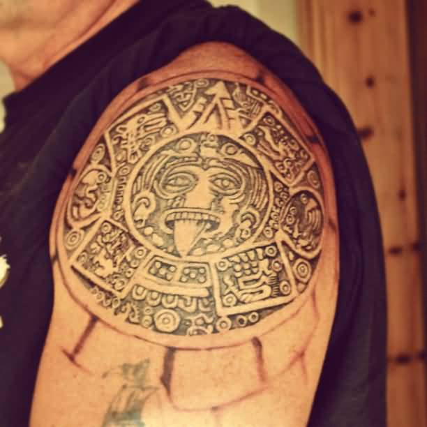 Massive Aztec Mask Tattoo For Men's Upper Sleeve