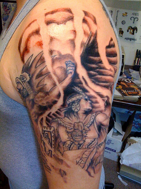 Men Shows Aztec Warrior Tattoo On Upper Arm