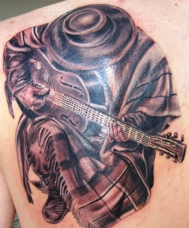 Men Shows Band Man And Guitar Tattoo On Upper Back