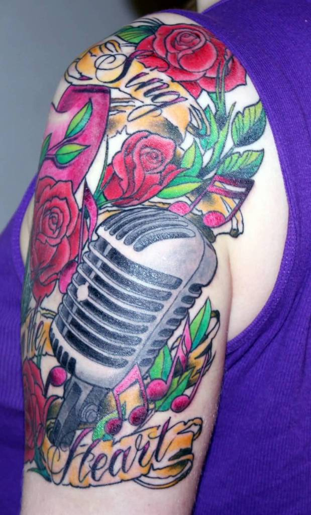 Nice Heart Text And Band Mic Tattoo For Lady