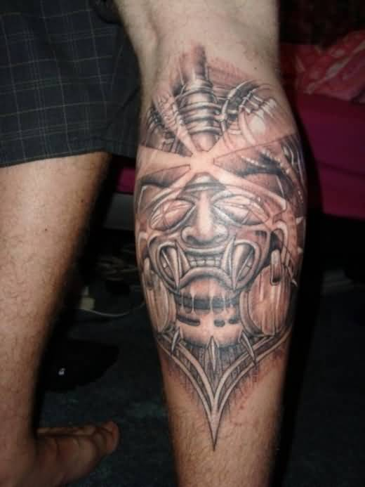 Scary Aztec And God Sun Tattoo On Calf