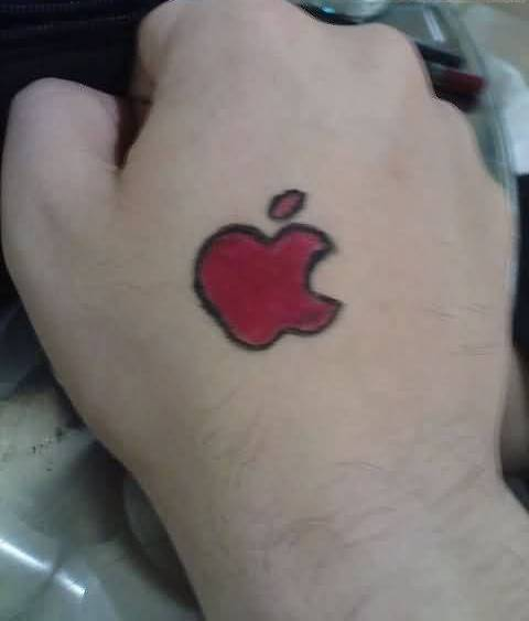 Tiny Apple Bite Tattoo On Hand