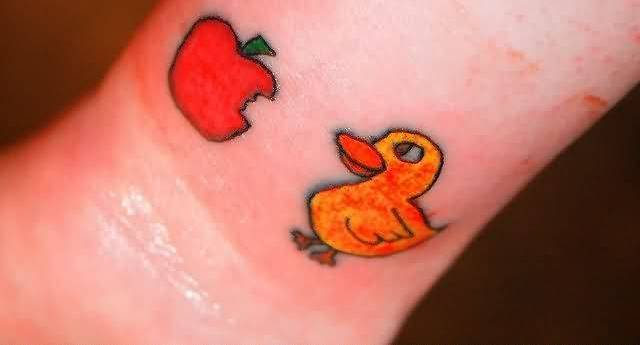 Famous Apple Bite Tattoo With Duck