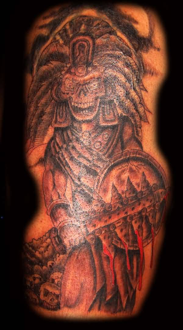 Spooky aztec skull hold shield and sword tattoo for Aztec lion tattoo meaning