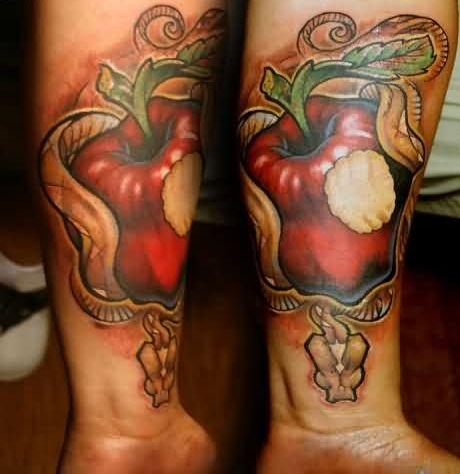 Lower Arm Tattoo Of Apple Bite