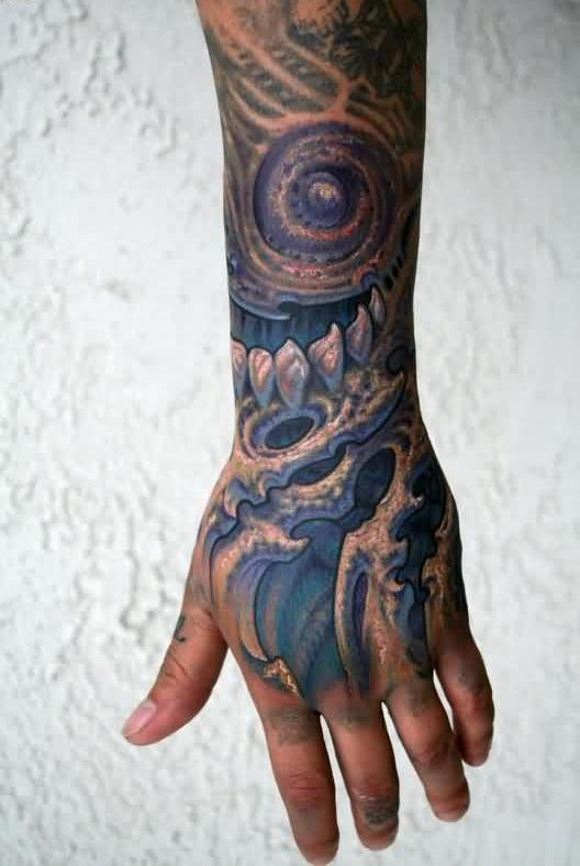 Lower Arm Tattoo Of Biomechanical Alien