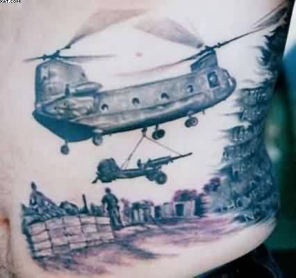 Wonderful Army Helicopter Hold Launcher Tattoo On Ribs