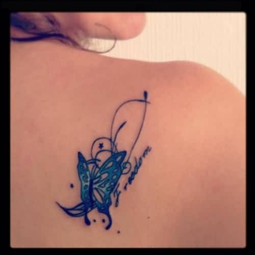 Amazing Freedom Text And Lovely Butterfly Tattoo On Upper Back