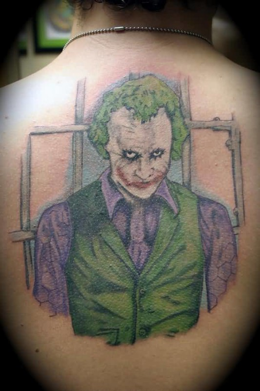 Angry Jonathan Joker CartoonTattoo Design Make On Upper Back 4