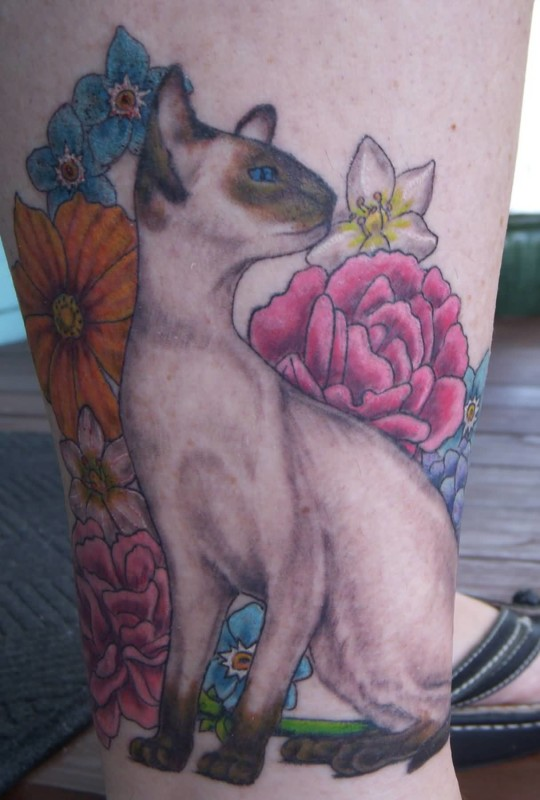 Beautiful Flowers And Nice Looking Crazy Cat Tattoo Make On Leg 7