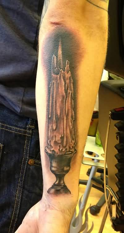 Brilliant Melting Candle And Holder Tattoo Make On Men's Forearm 6