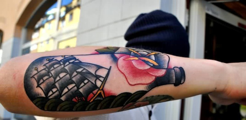 Cool Men Show Ship In Bottle Tattoo On Lower Sleeve    6