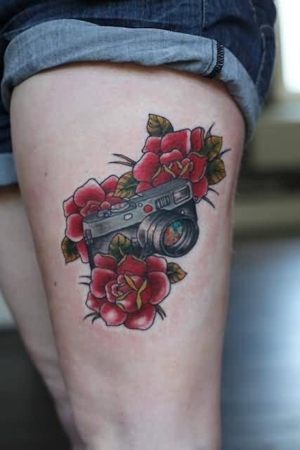 Fabulous Red Rose And Simple Camera Tattoo On Women's Thigh 1