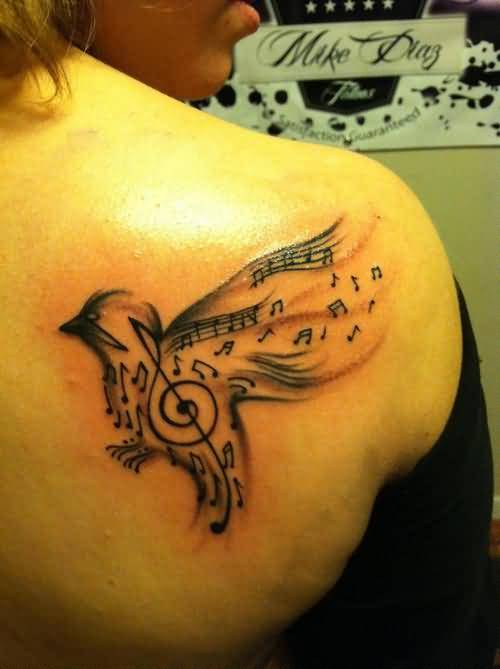 Famous Music Notes And Flying Birds Tattoo Design On Women's Back Shoulder3