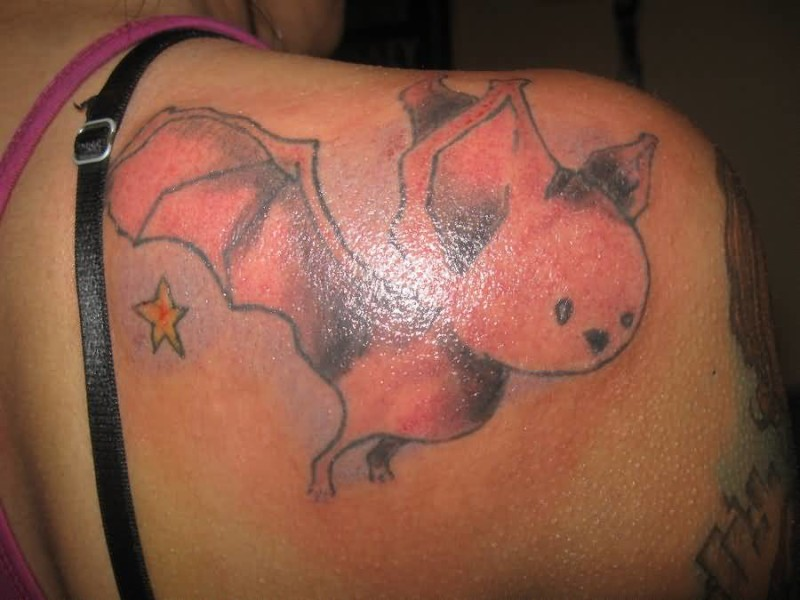 Flying Funny Cartoon Tattoo On Lady's Back Shoulder 5