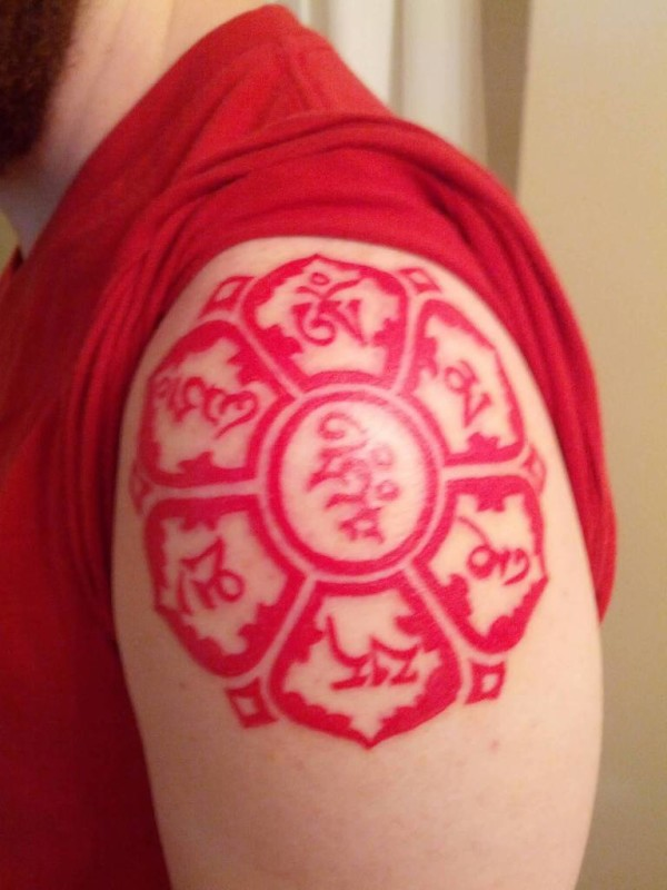 Funky Men Show Red Buddhist Symbol Tattoo On Shoulder     6