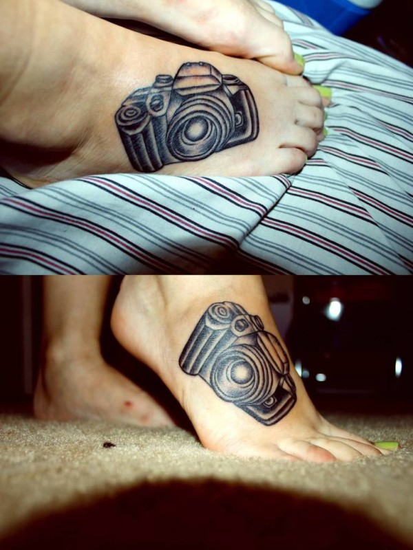 Great Looking Black Camera Tattoo Make On Women's Foot 7