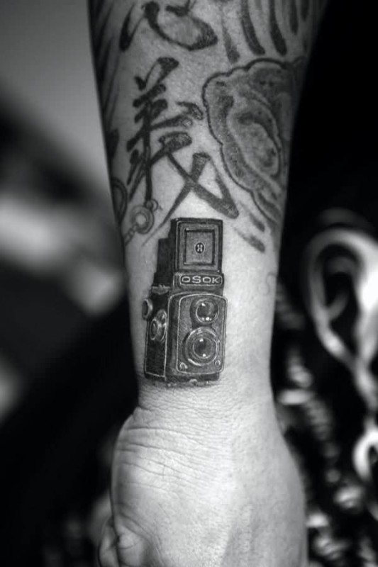 cd1e66834 Great Looking Tiny Black And White Film Camera Tattoo On Wrist