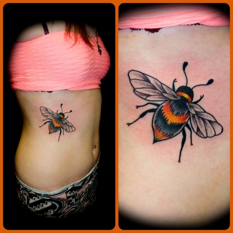 Hot Lady Show Traditional Bumblebee Tattoo On Rib Side 7