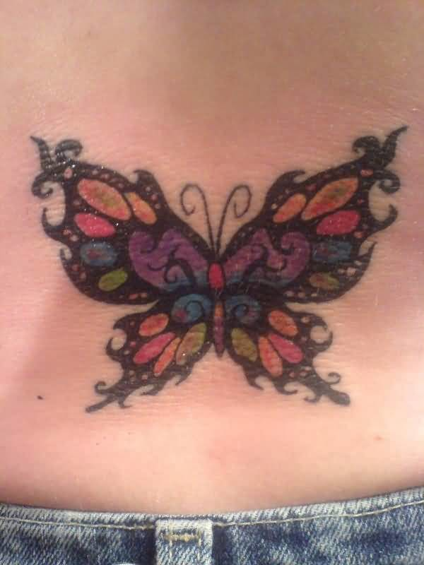 Lady lower back cover up with colorful butterfly tattoo for Cover up tattoos ideas for lower back