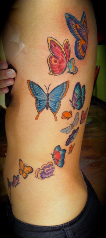 Lady Rib Cover Up With Nice Looking Flying Butterfly Tattoo 6