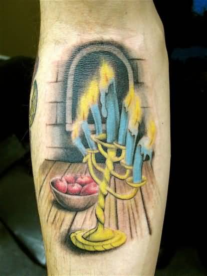 Lovely Blue Burning Candles And Stick Tattoo Design Make On Forearm 2