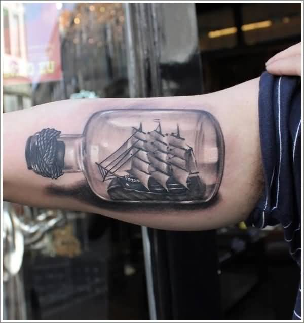 Lovely Ship In Sealed Bottle Tattoo On Upper Sleeve  4