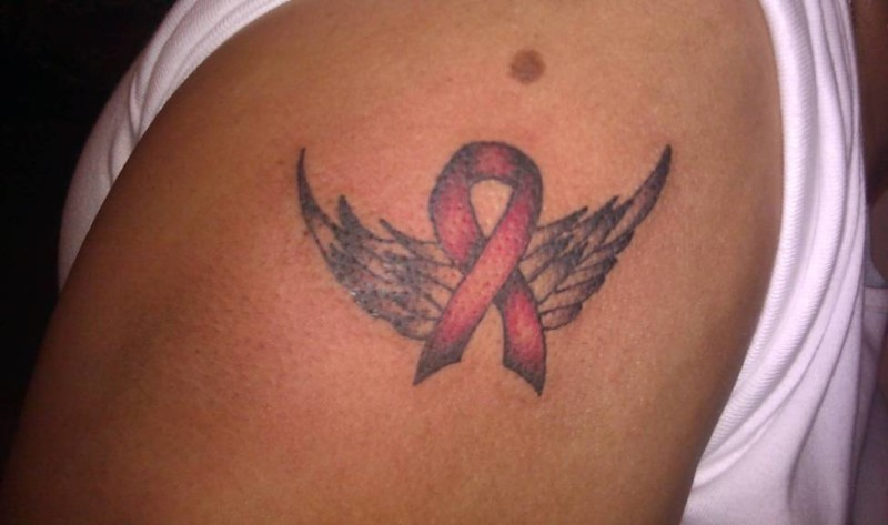 Great Looking Breast Cancer Symbol And Angel Wings Tattoo For