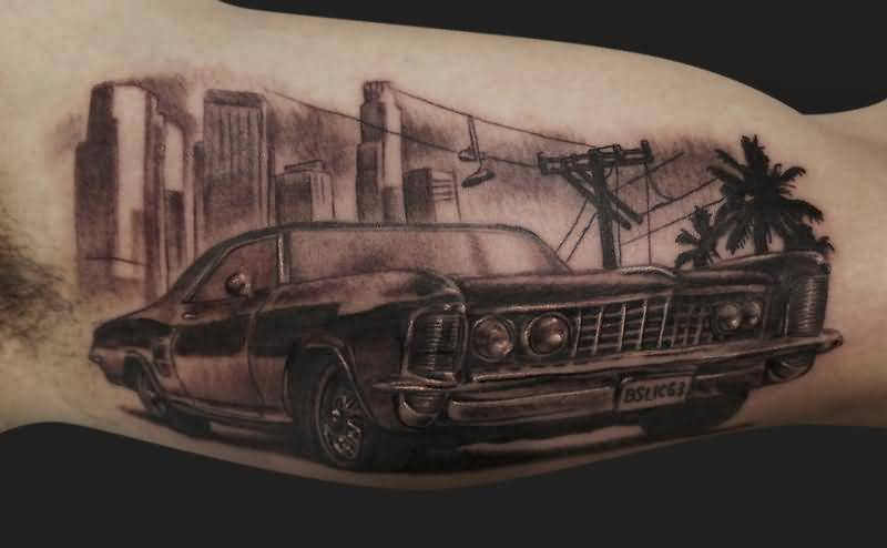Nice Looking Famous Car Tattoo On Men's Inner Bicep 2