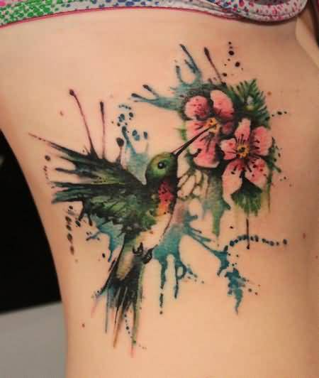 Nice Looking Humming Bird With Flowers Tattoo For Women1