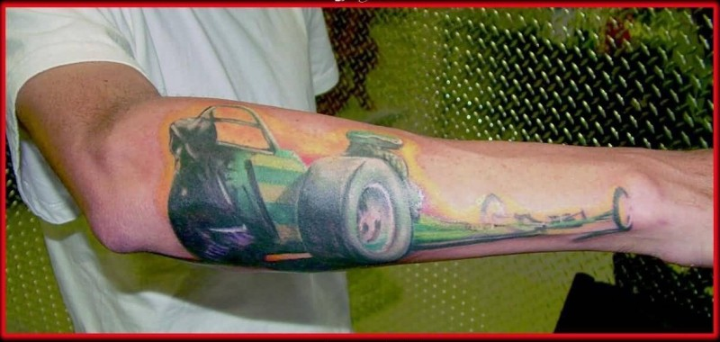 Nice Looking Lower Sleeve Tattoo Of Brilliant Green Racing Car Tattoo 7