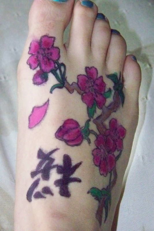 Outstanding Purple Cherry Blossom With Black Chinese Letters Tattoo Design Make On Women's Foot 28