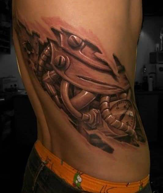 Outstanding Ripped Skin Biomechanical Tattoo For Stylish Men2